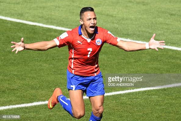 Chile's forward Alexis Sanchez celebrates after scoring a goal during the Round of 16 football match between Brazil and Chile at The Mineirao Stadium...