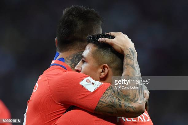 Chile's forward Alexis Sanchez is congratulated by a teammate after scoring a goal during the 2017 Confederations Cup group B football match between...