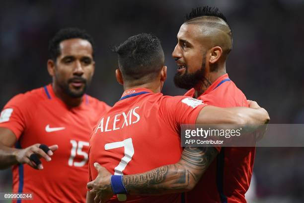 Chile's forward Alexis Sanchez is congratulated by Chile's midfielder Arturo Vidal and Chile's defender Jean Beausejour after scoring a goal during...