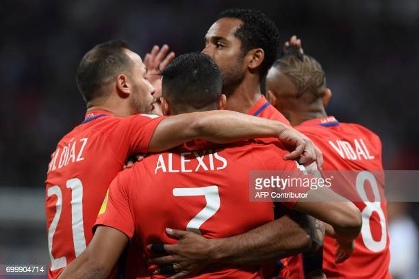 Chile's forward Alexis Sanchez is congratulated by teammates after scoring a goal during the 2017 Confederations Cup group B football match between...