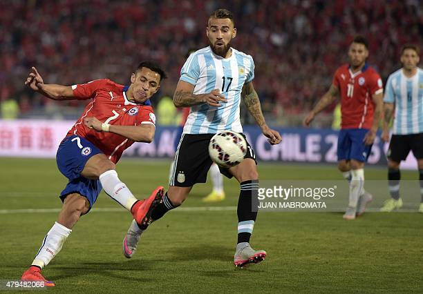 Chile's forward Alexis Sanchez kicks the ball marked by Argentina's defender Nicolas Otamendi during their 2015 Copa America football championship...