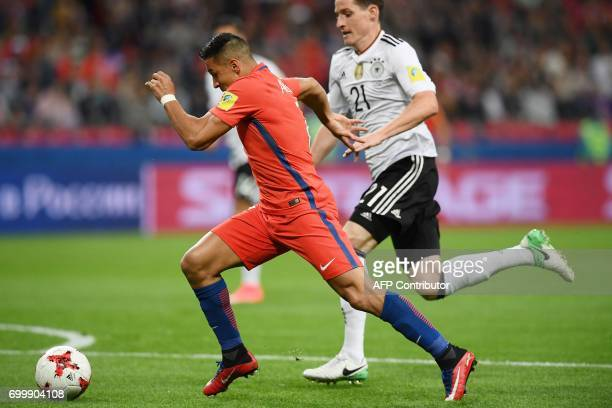 Chile's forward Alexis Sanchez kicks to score a goal during the 2017 Confederations Cup group B football match between Germany and Chile at the Kazan...
