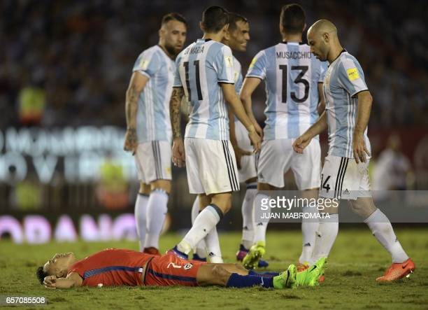 Chile's forward Alexis Sanchez lies on the pitch after being fouled by Argentina's defender Nicolas Otamendi during a 2018 FIFA World Cup Russia...