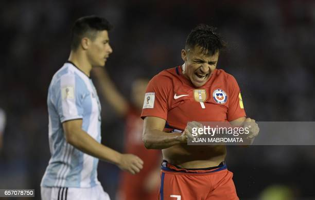 Chile's forward Alexis Sanchez reacts after missing a chance of goal during the 2018 FIFA World Cup qualifier football match against Argentina at the...