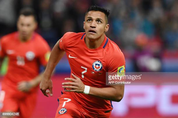 TOPSHOT Chile's forward Alexis Sanchez reacts after scoring a goal during the 2017 Confederations Cup group B football match between Germany and...