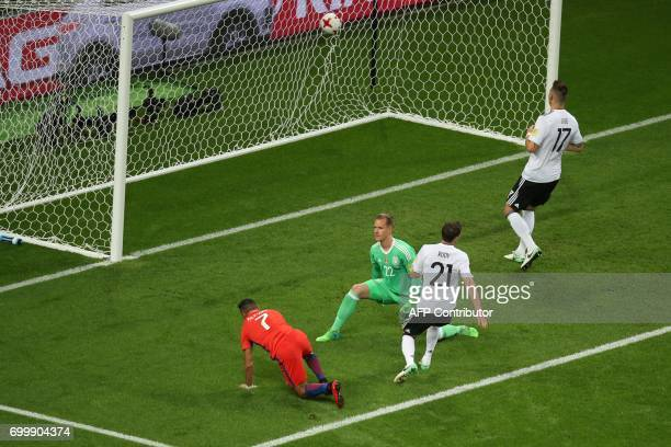 Chile's forward Alexis Sanchez scores a goal past Germany's goalkeeper MarcAndre Ter Stegen during the 2017 Confederations Cup group B football match...