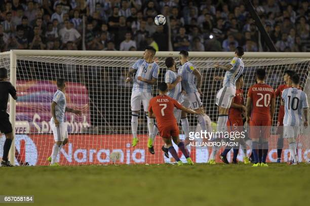 Chile's forward Alexis Sanchez shoots against Argentina during their 2018 FIFA World Cup qualifier football match at the Monumental stadium in Buenos...