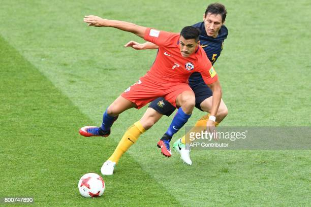 TOPSHOT Chile's forward Alexis Sanchez vies Australia's midfielder Mark Milligan with during the 2017 Confederations Cup group B football match...