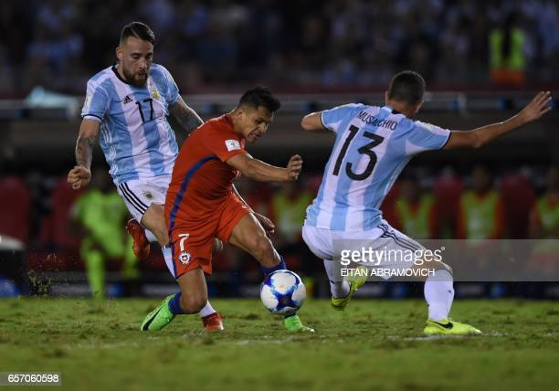 Chile's forward Alexis Sanchez vies for the ball with Argentina's Nicolas Otamendi and Argentina's Mateo Mussacchio during their 2018 FIFA World Cup...