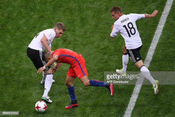 Chile's forward Alexis Sanchez vies with Germany's defender Matthias Ginter and Germany's defender Joshua Kimmich during the 2017 Confederations Cup...