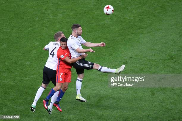 Chile's forward Alexis Sanchez vies with Germany's defender Shkodran Mustafi and Germany's defender Matthias Ginter during the 2017 Confederations...