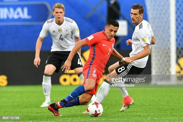 TOPSHOT Chile's forward Alexis Sanchez vies with Germany's midfielder Leon Goretzka during the 2017 Confederations Cup final football match between...