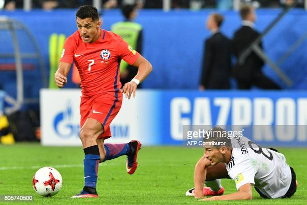Chile's forward Alexis Sanchez vies with Germany's midfielder Leon Goretzka during the 2017 Confederations Cup final football match between Chile and...