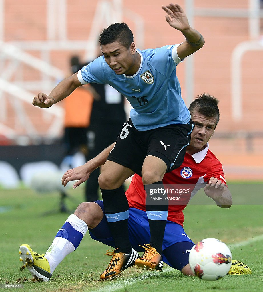 Chile's forward Diego Rubio vies for the ball with Uruguay's defender Maximiliano Moreira during their South American U-20 final round football match at Malvinas Argentinas stadium in Mendoza, Argentina, on January 27, 2013. Four South American teams will qualify for the FIFA U-20 World Cup Turkey 2013.