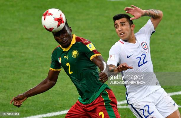 Chile's forward Edson Puch challenges Cameroon's defender Ernest Mabouka during the 2017 Confederations Cup group B football match between Cameroon...