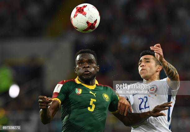 Chile's forward Edson Puch challenges Cameroon's defender Michael NgadeuNgadjui during the 2017 Confederations Cup group B football match between...
