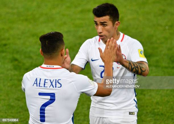 Chile's forward Edson Puch is replaced by Chile's forward Alexis Sanchez during the 2017 Confederations Cup group B football match between Cameroon...