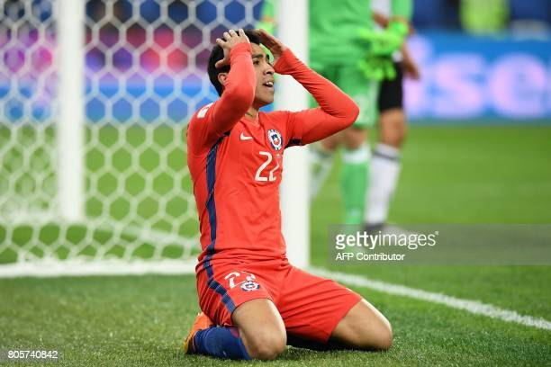 Chile's forward Edson Puch reacts during the 2017 Confederations Cup final football match between Chile and Germany at the Saint Petersburg Stadium...