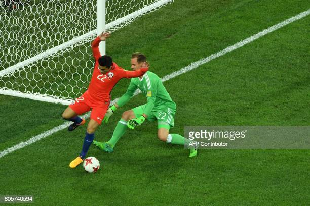 Chile's forward Edson Puch vies with Germany's goalkeeper MarcAndre Ter Stegen during the 2017 Confederations Cup final football match between Chile...