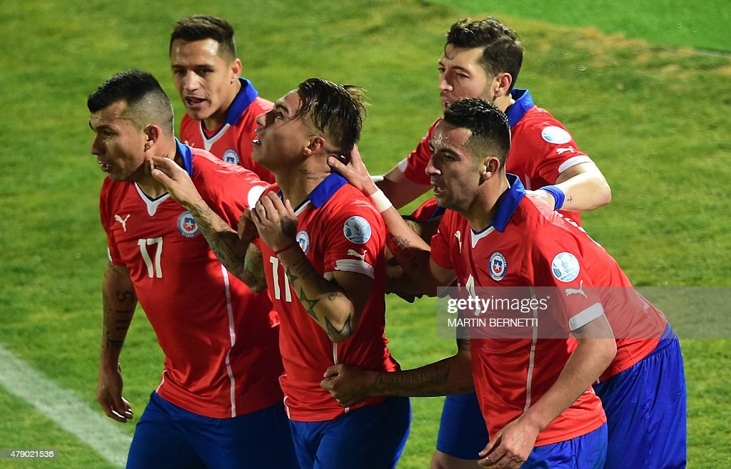 Chile's forward Eduardo Vargas celebrates with teammates after scoring against Peru during their 2015 Copa America football championship semifinal...