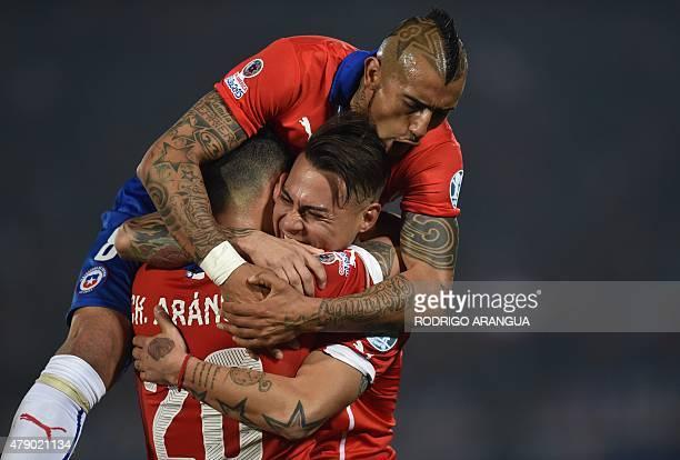 Chile's forward Eduardo Vargas celebrates with teammates Charles Aranguiz and Arturo Vidal after scoring against Peru during their 2015 Copa America...