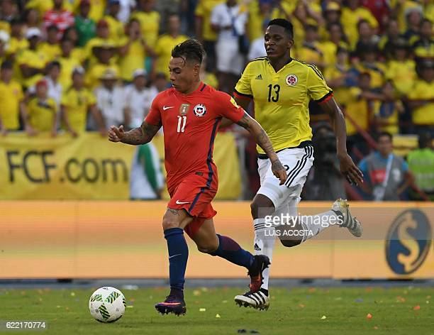 Chile's forward Eduardo Vargas drives the ball past Colombia's defender Yerry Mina during their 2018 FIFA World Cup qualifier football match in...