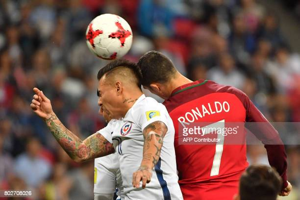 TOPSHOT Chile's forward Eduardo Vargas vies with Portugal's forward Cristiano Ronaldo during the 2017 Confederations Cup semifinal football match...