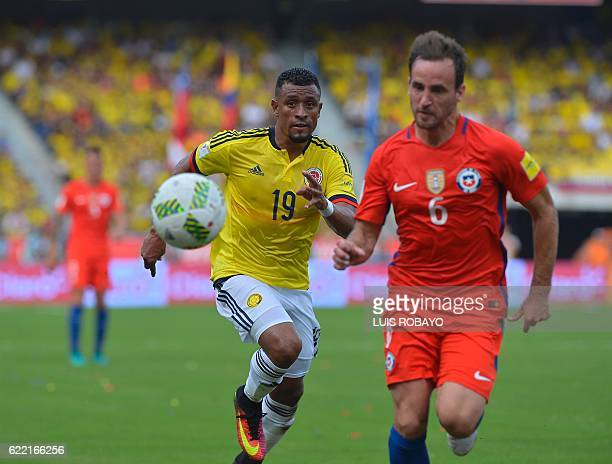 Chile's forward Jose Fuenzalida and Colombia's defender Farid Diaz vie for the ball during their WC 2018 qualification football match in Barranquilla...