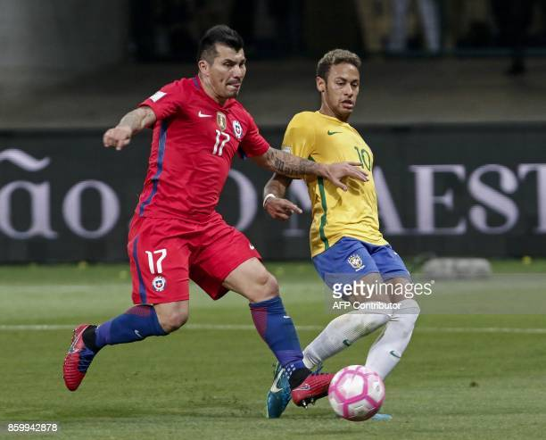 Chile's Gary Medel and Brazil's Neymar vie for the ball during their 2018 World Cup football qualifier match in Sao Paulo Brazil on October 10 2017 /...