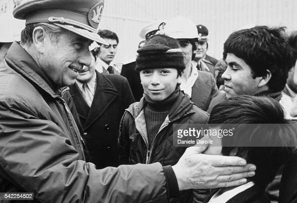 Chile's General Augusto Pinochet greets compatriots in the streets of Santiago