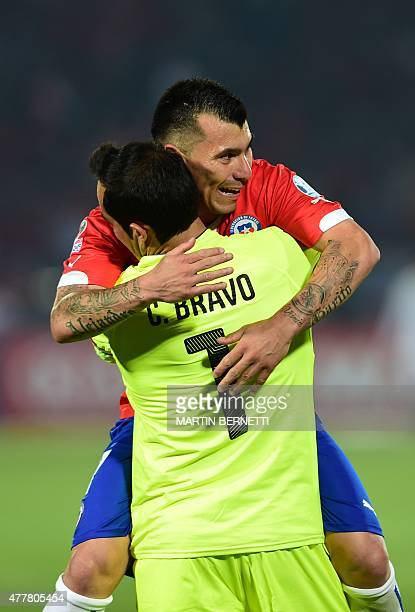 Chile's goalkeeper Claudio Bravo and defender Gary Medel celebrate after teammate Charles Aranguiz scored against Bolivia during their 2015 Copa...