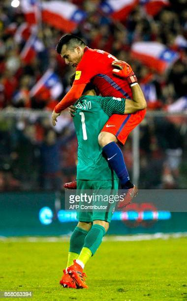 Chile's goalkeeper Claudio Bravo and Gary Medel celebrates after teammate Alexis Sanchez scored against Ecuador during their 2018 World Cup qualifier...