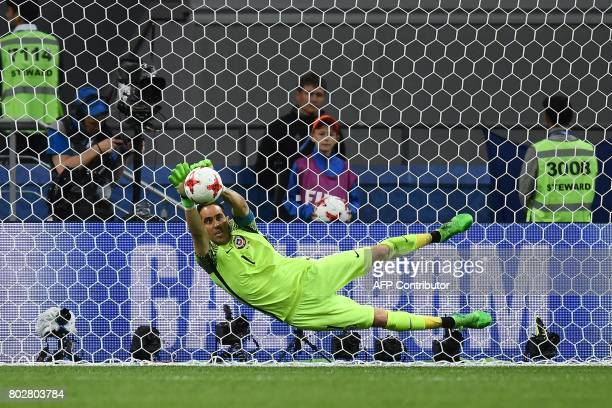TOPSHOT Chile's goalkeeper Claudio Bravo blocks the ball by Portugal's forward Ricardo Quaresma during a penalty shootout during the 2017...