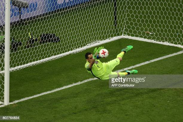Chile's goalkeeper Claudio Bravo deflects the ball in the penalty shoot out during the 2017 Confederations Cup semifinal football match between...