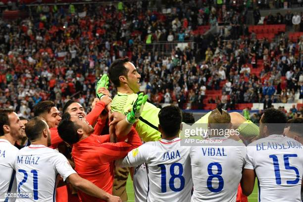 TOPSHOT Chile's goalkeeper Claudio Bravo is lifted after Chile won the 2017 Confederations Cup semifinal football match between Portugal and Chile at...
