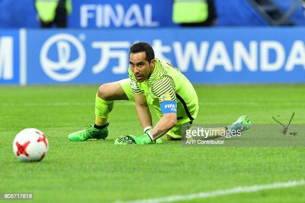 Chile's goalkeeper Claudio Bravo reacts after Germany scored the first goal of the match during the 2017 Confederations Cup final football match...