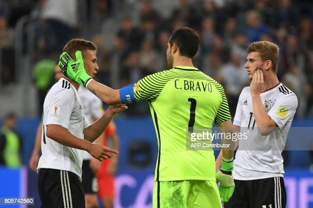 Chile's goalkeeper Claudio Bravo reacts to Germany's defender Joshua Kimmich as Germany's forward Timo Werner looks on during the 2017 Confederations...