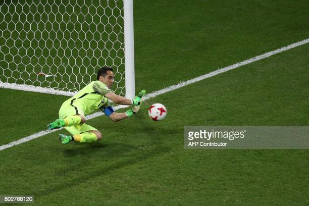 Chile's goalkeeper Claudio Bravo stop the penalty shoot by Portugal's forward Nani during the 2017 Confederations Cup semifinal football match...