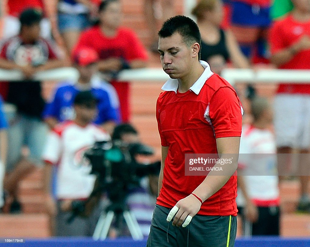 Chile's goalkeeper Dario Melo walks out of the field during their Group A South American U-20 qualifier football match against Colombia at Malvinas Argentinas stadium in Mendoza, Argentina, on January 13, 2013. Four teams will qualify for the FIFA U-20 World Cup Turkey 2013.