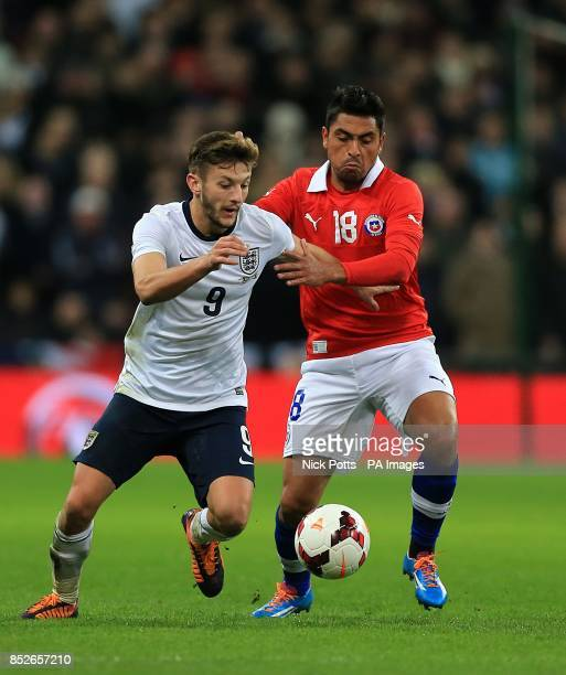 Chile's Gonzalo Jara and England's Adam Lallana battle for the ball
