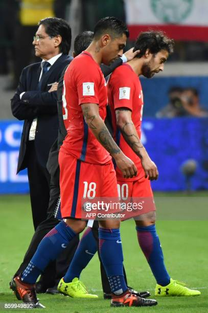 Chile's Gonzalo Jara and Jorge Valdivia show their dejection after being defeated by Brazil in a qualifier match and missing the 2018 World Cup...