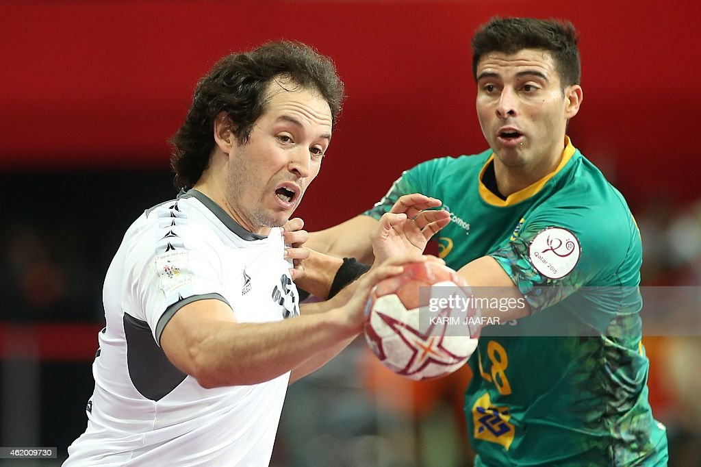 Chile's Guillermo Araya (L) attempts a shot on goal despite of Brazil's <a gi-track='captionPersonalityLinkClicked' href=/galleries/search?phrase=Felipe+Ribeiro&family=editorial&specificpeople=4113764 ng-click='$event.stopPropagation()'>Felipe Ribeiro</a> during the 24th Men's Handball World Championships preliminary round Group A match between Brazil and Chile at the Lusail Sports Arena in Doha on January 23, 2015.