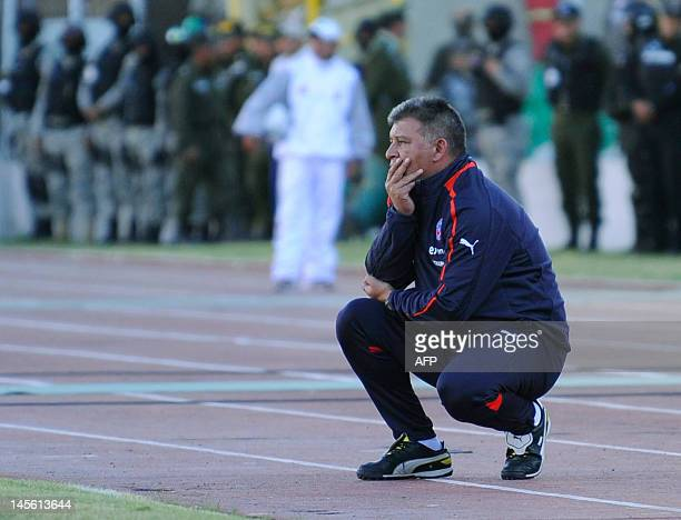 Chile's head coach Claudio Borghi watches Brazil 2014 FIFA World Cup South American qualifier football match between Chile and Bolivia at the...