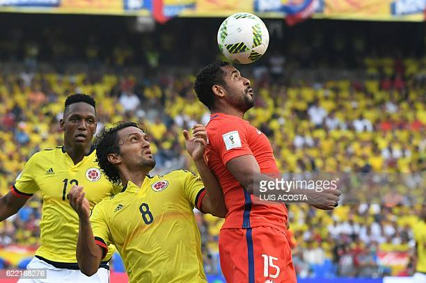 Chile's Jean Beausejour Colombia's midfielder Abel Aguilar and Colombia's defender Yerry Mina vie for the ball during their 2018 FIFA World Cup...