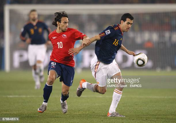 Chile's Jorge Valdivia and Spain's Sergio Busquets battle for the ball