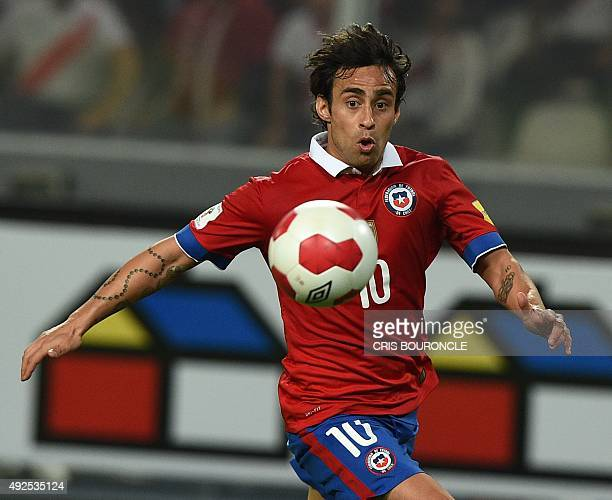 Chile's Jorge Valdivia eyes the ball during their Russia 2018 World Cup South American qualifier match between Chile and Peru played at the National...