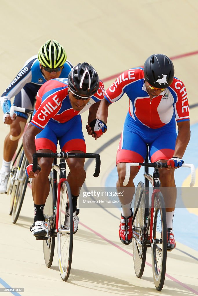 Chile's Luis Sepulveda (L) and Antonio Cabrera (R) compete during the ciclyng event as part of the XVII Bolivarian Games Trujillo 2013 at Colegio San Agustin Velodrome on November 20, 2013 in Chiclayo, Peru.
