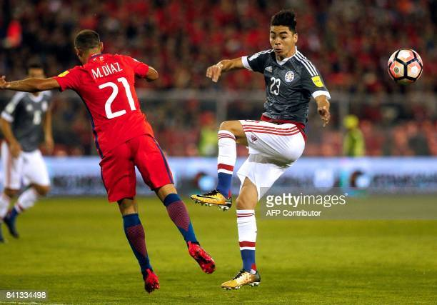 Chile's Marcelo Diaz and Paraguay's Miguel Almiron vie for the ball during their 2018 World Cup qualifier football match in Santiago on August 31...