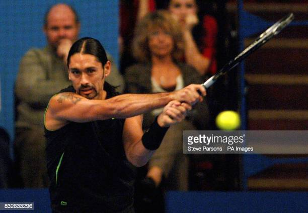 Chile's Marcelo Rios in action against John McEnroe during the Blackrock Masters at the Royal Albert Hall London
