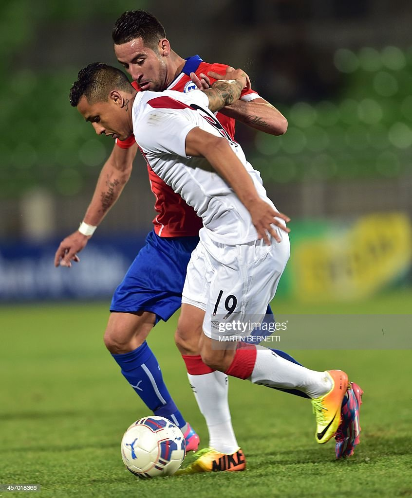 Chile s Mauricio Isla back vies for the ball with Peru s Victor